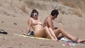 Nasty babe fucks a guy in a beach curvaceous of voyeurs