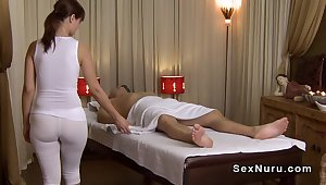 Busty masseuse anent undershirt gives massage