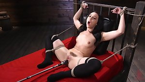 Submissive brunette in rough scenes of fucking machine XXX