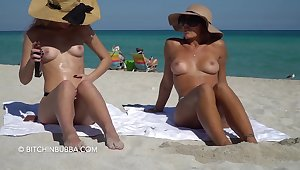 Amoral girls with nice tits on the beach